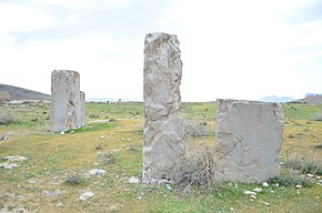 Photograph of three columns of different sizes at Istakhr