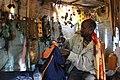 Ethiopia WenkshetMonastery ManInspectingBag.JPG