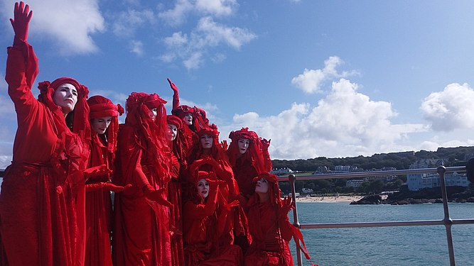 Extinction Rebellion 'Red Brigade' at the end of Smeaton's Pier in St Ives, Cornwall August 2019.jpg