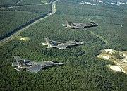 F-35 Lightning II variants in flight near Eglin AFB in 2014