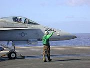 F/A-18 attached to catapult on the flight deck of USS Abraham Lincoln.