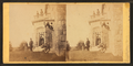 Family posing in front and in the balcony of stone house, from Robert N. Dennis collection of stereoscopic views.png