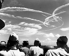 Fighter plane contrails in the sky
