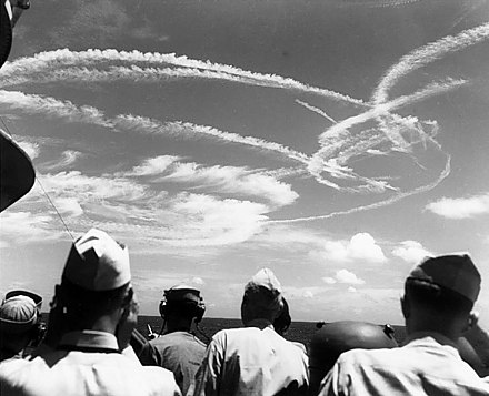 Fighter aircraft contrails mark the sky over Task Force 58, June 19, 1944 Fighter plane contrails in the sky.jpg