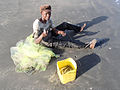 Fisher who are just fixed his net the Gambia.jpg