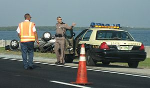 Florida Highway Patrol - A state trooper supervising the cleanup of a traffic accident in Troop C.