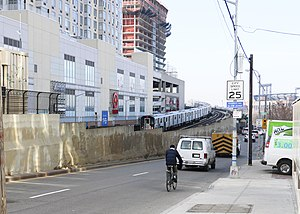 Flushing–Main Street (IRT Flushing Line) - Flushing Line tunnel portal at College Point Boulevard
