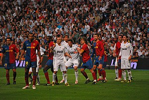 Éric Abidal - Abidal (far right) playing against Real Madrid.