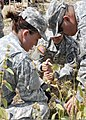 From left, U.S. Army Spc. Vilmary Natal, Spc. Jessica Isales and Spc. Jose Arroyo, all members of the 192nd Water Purification Section, 192nd Brigade Support Battalion, Puerto Rico Army National Guard 130209-A-ZZ999-004.jpg