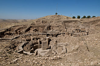 Temple - Göbekli Tepe was founded about 11,500 years ago. Its circular compounds on top of a tell are composed by massive T-shaped stone pillars decorated with abstract, enigmatic pictograms and animal reliefs. It is arguably world's oldest temple.