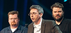 "Portal 2 - Writers Jay Pinkerton (left), Erik Wolpaw, and Chet Faliszek at the 2012 Game Developers Conference receiving the ""Best Narrative"" award for Portal 2"