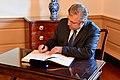 Giorgi Kvirikashvili signs Sec Pompeo's guestbook.jpg