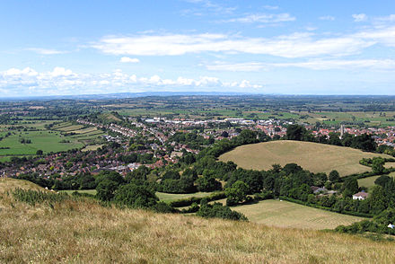 The town of Glastonbury looking west from the top of Glastonbury Tor. The fields in the distance are the Somerset Levels. Glastonbury (part of) from the tor arp.jpg