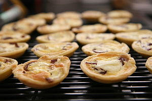 Goat cheese tarts on a rack.