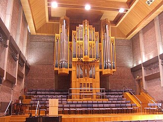 City of London School - The Great Hall stage and Walker organ, originally designed for the Victoria Embankment school building.