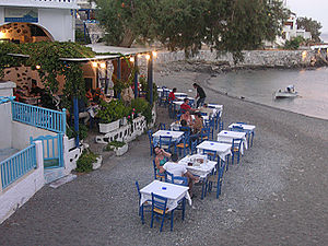 Greek restaurant - Patrons dining outdoors at a Greek restaurant