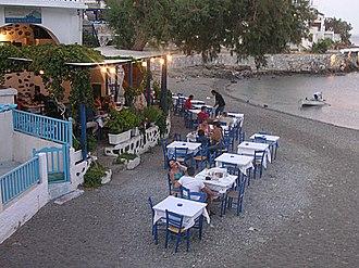 Greek restaurant - Patrons dining outdoors at a Greek restaurant