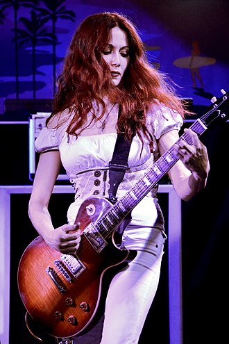 Guitarist - Guitarist Gretchen Menn of rock tribute band Zepparella performing at the 3rd Annual Malibu Guitar Festival in 2017.