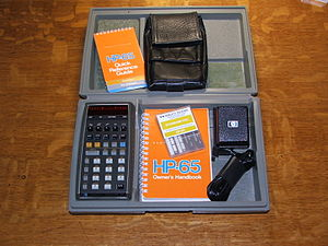 """HP-65 - HP-65 in original hard case with manuals, software """"Standard Pac"""" of magnetic cards, soft leather case, and charger"""