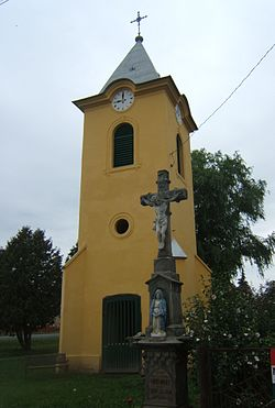 Bell tower with stone cross in Böhönye