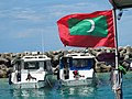 Harbor Scene with Maldives Flag - Male - Maldives (14271350633).jpg