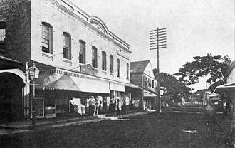 Henry Martyn Whitney - The Hawaiian Gazette building in 1880s