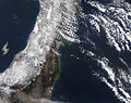 Heavy black plume of smoke streams southeast from Sendai, Japan.jpg