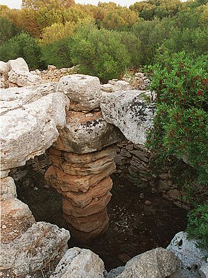 Talaiotic culture - Central column and the slabs of the roof of a talaiot in Majorca.