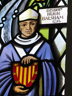 Hugh de Balsham - Hugh Balsham shown in a window at Thriplow church in Cambridgeshire, holding the coat of arms of Peterhouse