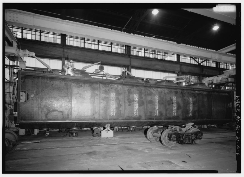 File:INTERIOR VIEW, LOOKING SOUTH, WITH CAR 'DETRUCKED AND TURNED UPSIDE DOWN' FOR WELDING UNDERSIDE OF THE CAR AND INSIDE OF THE ROOF. IN FOREGROUND ARE THE WHEELS REMOVED TO HAER ALA,37-BES,4A-6.tif