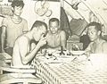 Indonesian sailors eating on submarine, Jalesveva Jayamahe, p185.jpg