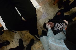 Injured protester receiving first medical aid in field. Kyiv, Ukraine. Jan 22, 2014-2.jpg
