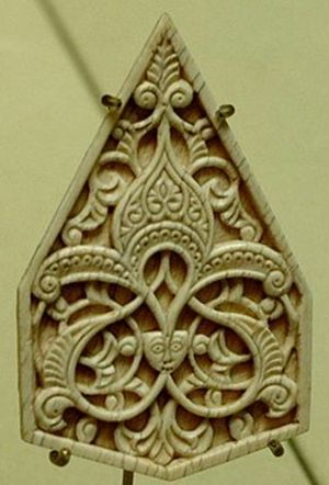 Style (visual arts) - 14th-century Islamic ornament in ivory, centred on a palmette; Alois Riegl's Stilfragen (1893) traced the evolution and transmission of such motifs.