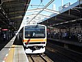 JR East Kuha 208-506 at Minami-Koshigaya Station.jpg