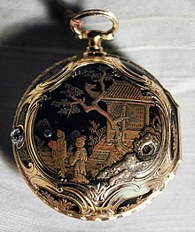 A pocket watch with an intricate Asian-themed design painted on it