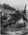 Japanese attack on Pearl Harbor. Wrecked USS DOWNES at left and USS CASSIN at right. In the rear is the USS... - NARA - 520593.tif