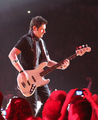 Jay DeMarcus Performing During Rascal Flatts Thaw Out 2012 Tour.png