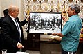 Jean-Yves Le Drian presenting a memento depicting brave Indian soldiers who participated in World War-I, to the Union Minister for Defence, Shri Manohar Parrikar, in New Delhi on December 02, 2014.jpg