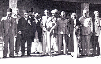 Pakistani philosophy - M.A. Jinnah (middle) and Fatima Jinnah (3rd right), stands with the Muslim philosophers at the convention who presented the Idea of Pakistan, circa before 1947.