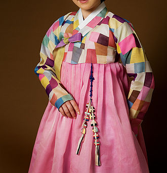 Patchwork - Woman wearing a traditional jeogori (jacket) made with Jogakbo, or Korean patchwork
