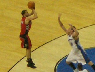 José Calderón (basketball) - Calderón taking a jump shot in a 2006–07 game against the Washington Wizards