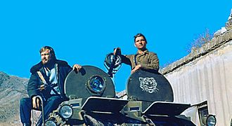 KGB - KGB special operative Igor Morozov sits on top of the BTR-80 armored vehicle during his assignment to the Badakhshan province, c. 1982