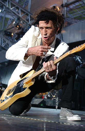 Keith Richards - Richards performing with the Rolling Stones in 2003