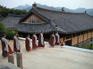 Korean Buddhism - Monks going down to their rooms after evening prayers at Haeinsa.