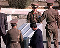 Korean People's Army Soldiers unload nine caskets of remains which they will repatriate during a repatriation ceremony at the Panmunjom Joint Security Area on 981106-F-AF179-507.jpg