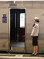 Kyushu rail stewardess ready to welcome me to her train (250355140).jpg