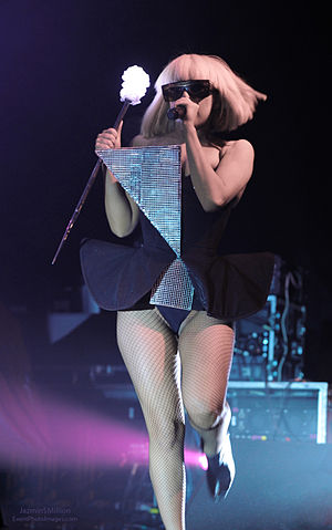 "LoveGame - Gaga wearing a black dress with a triangular piece and holding her disco stick, performs ""LoveGame"" on The Fame Ball Tour"