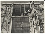 Laying the formwork for a tunnel near one of the abutments, 1931 (8283763060).jpg