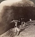 Left- Gazing through sulphurous vapors into the crater's frightful depths, Aso-San, Japan (1904), by Underwood & Underwood (cropped).jpg