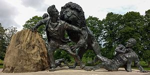 David Livingstone Centre - Livingstone and the Lion bronze by Ray Harryhausen and Gareth Knowles in the gardens of the centre